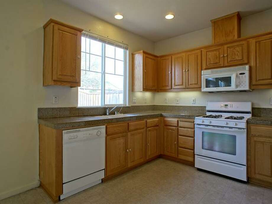 The kitchen was upgraded with granite countertops.