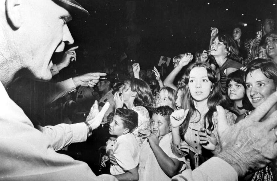 A Houston Police officer has a few words with concert goers at the Beatles concert in the Sam Houston Coliseum, Houston, Texas, Aug. 19, 1965. Photo: Chronicle File