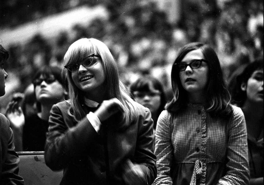 The girl at left is wearing the collarless suit the Beatles wore in 1963. Sam Houston Coliseum, Houston, Texas, Aug. 19, 1965. Photo: Chronicle File