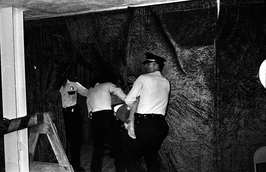 A concert goer is carried out by Houston Police during the Beatles concert at the Sam Houston Coliseum. Photo: Chronicle File