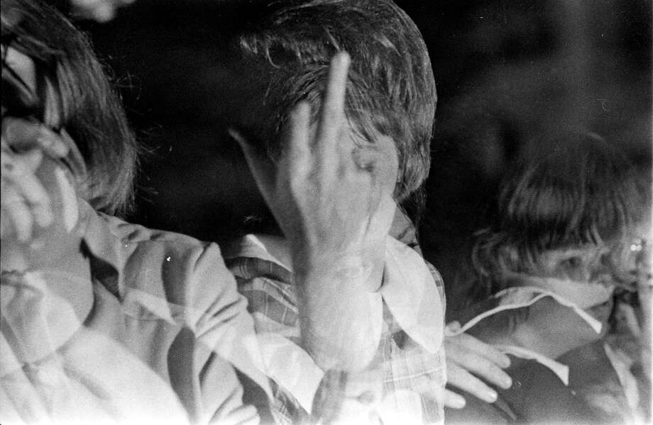 A concert goer takes notice of a Houston Chronicle photographer at the Beatles concert in the Sam Houston Coliseum, Houston, Texas, Aug. 19, 1965. Photo: Chronicle File