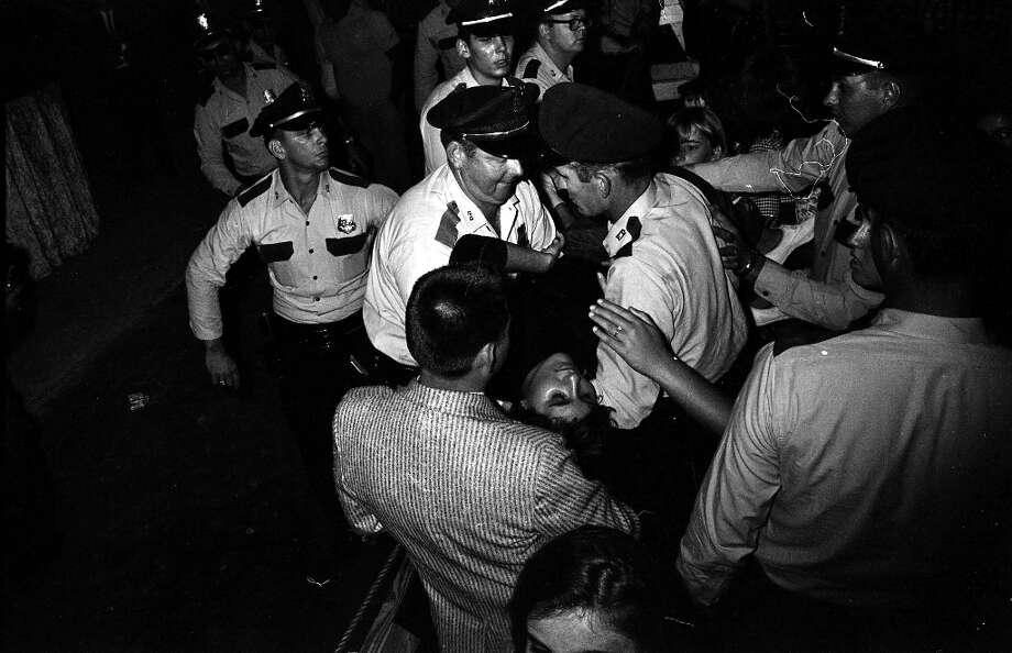 Authorities tend to a fan who has passed out at the Beatles concert at the Sam Houston Coliseum. Photo: Chronicle File