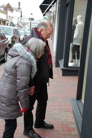 Jim Goodrich and his wife Luisa Francoeur of Westport take a closer look at a work of bird art Thursday during the Birdshouse Stroll sponsored downtown by Project Return.  WESTPORT NEWS, CT 3/21/13 Photo: Jarret Liotta / Westport News