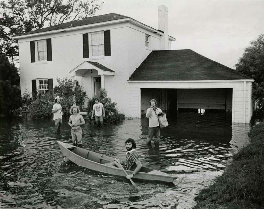 In 1977. Dan Peters paddles in the front yard of a house he and Durwood Harmon rented in Brownwood. Photo: Othell O. Owensby, Houston Chronicle / Houston Chronicle