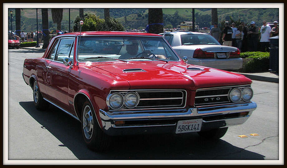 1964–1970 Pontiac GTO Despite the demise of Pontiac, there has been no discernible bump in the value of these cars. Lucky you. It means a classic GTO can be had for less than $30,000, thousands less than a similar, big-block Chevrolet Chevelle Super Sport. The powerful GT is widely credited as defining the muscle-car era. With massive big-block engine choices, it delivered up to 360 hp that was mated to a floor-mounted four-speed manual transmission.  Photo: Jack_Snell, Flickr Photo: Flickr