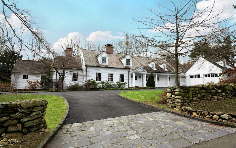 This Colonial Cape sits on just over an acre at 33 Old Hill Road. Built in 1812, it boasts 19th-century features such as wide-planked wood floors and papered walls in floral print while offering modern amenities such as a gourmet kitchen, updated baths, in-ground swimming pool and two garages. Photo: Contributed Photo