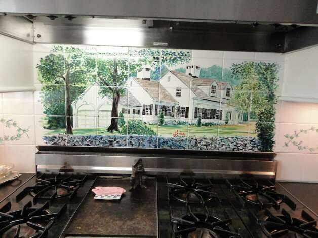 A hand-painted mural depicting the house can be found on the backsplash over the kitchen's range top. Photo: Contributed Photo