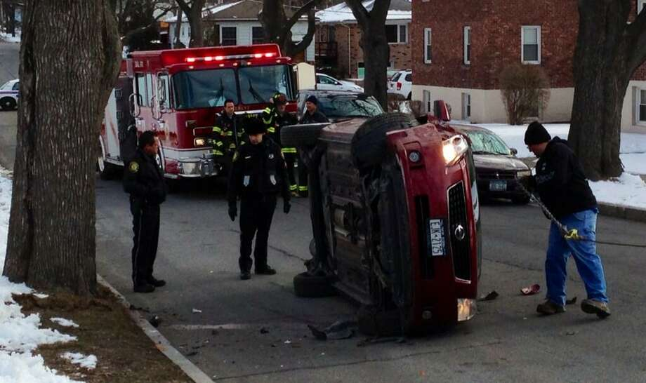 A car flipped on its side on Ontario Street near Mercer Street in Albany on Friday, March 22, 2013. (Skip Dickstein/Times Union)