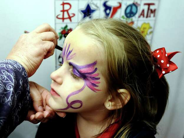 Five year old Emily Fisher of Beaumont has her face painted at the 70th Annual YMBL Southeast Texas State Fair in Beaumont that opened up Thursday, March 21, 2013. Photo taken: Randy Edwards/The Enterprise Photo: Randy Edwards