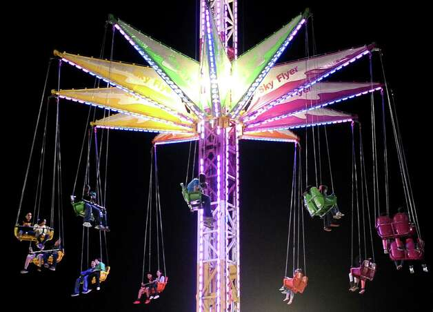 Residents of Southeast Texas ride the Skyflyer ride at the 70th Annual YMBL Southeast Texas State Fair in Beaumont that opened up Thursday, March 21, 2013. Photo taken: Randy Edwards/The Enterprise Photo: Randy Edwards