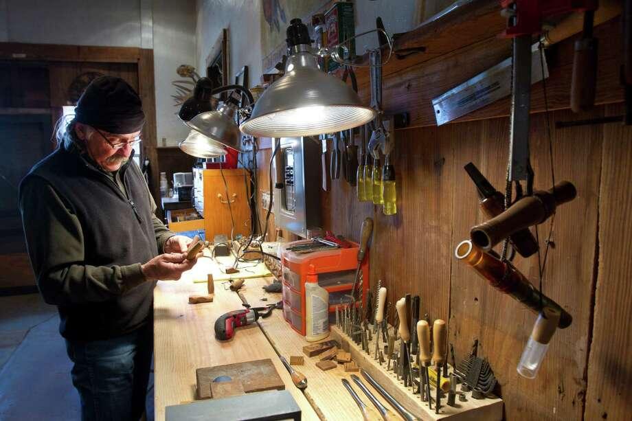 Meinzer works on predator calls in his workshop. Photo: Brett Coomer, Houston Chronicle / © 2013 Houston Chronicle