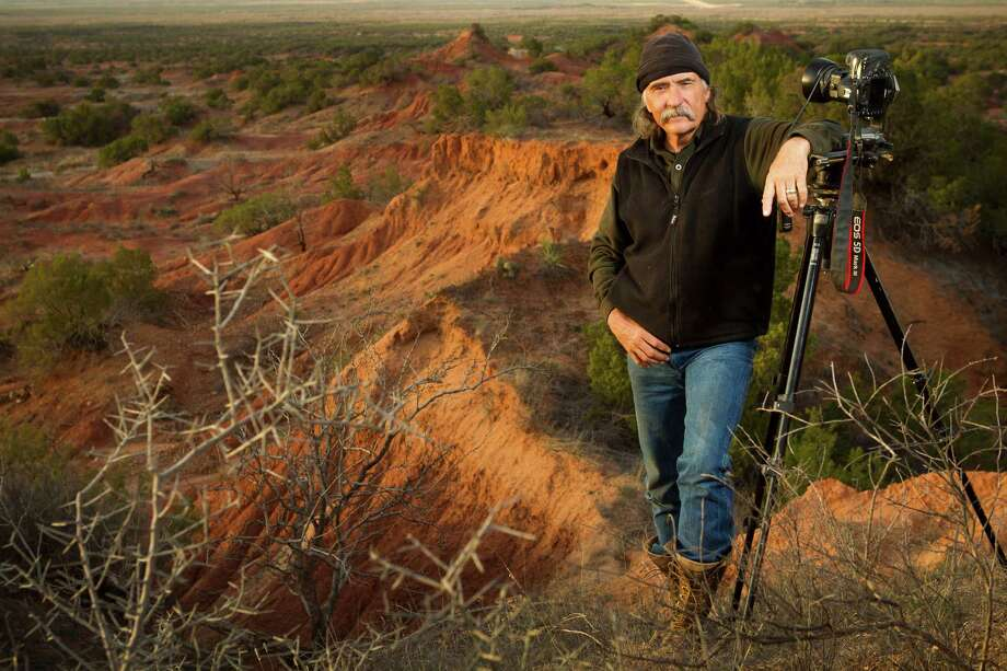 Texas photographer Wyman Meinzer poses for a portrait in the Knoco Badlands near Benjamin. Photo: Brett Coomer, Houston Chronicle / © 2013 Houston Chronicle