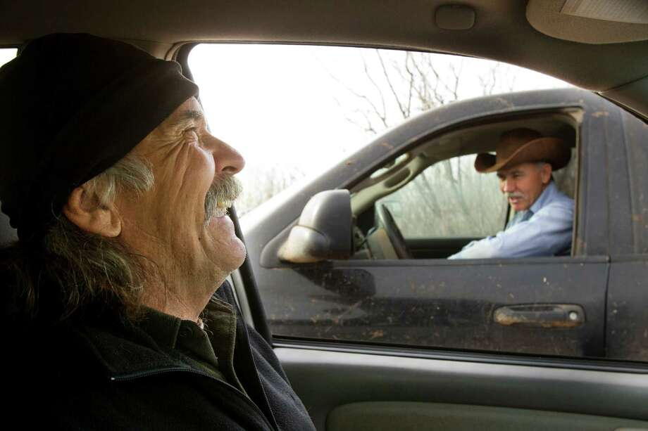 Photographer Wyman Meinzer, left, shares a laugh with his brother, Rick, at the Hurd Ranch. Photo: Brett Coomer, Houston Chronicle / © 2013 Houston Chronicle