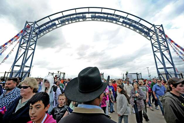 Patrons rush the gates after the opening ceremonies of  the 70th Annual YMBL Southeast Texas State Fair in Beaumont that opened up Thursday, March 21, 2013. Photo taken: Randy Edwards/The Enterprise