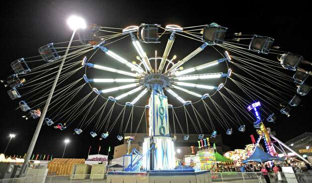 Residents of Southeast Texas ride the YO-YO ride at the 70th Annual YMBL Southeast Texas State Fair in Beaumont that opened up Thursday, March 21, 2013. Photo taken: Randy Edwards/The Enterprise Photo: Randy Edwards