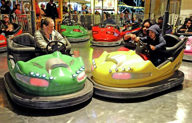 Residents of Southeast Texas ride the bumper cars ride at the 70th Annual YMBL Southeast Texas State Fair in Beaumont that opened up Thursday, March 21, 2013. Photo taken: Randy Edwards/The Enterprise