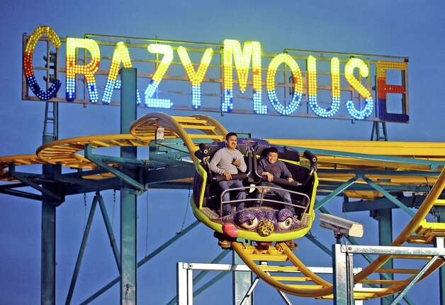 Carlos Alverez Junior and Senior ride the Crazy Mouse at the 70th Annual YMBL Southeast Texas State Fair in Beaumont that opened up Thursday, March 21, 2013. Photo taken: Randy Edwards/The Enterprise Photo: Randy Edwards