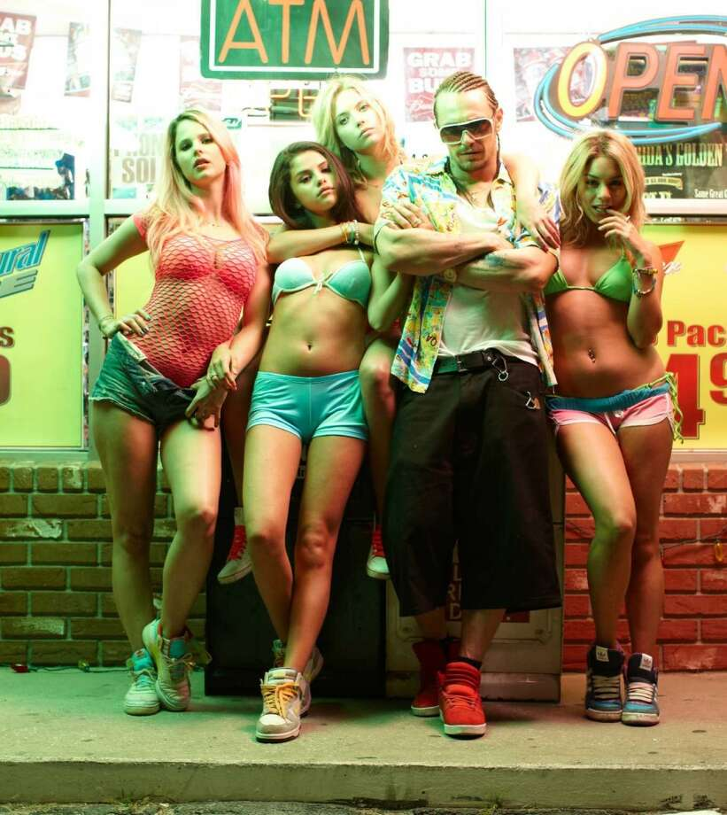 Vanessa Hudgens (right) and Selena Gomez (second from left) have said they hated their bikini costumes in ''Spring Breakers'' (pictured).