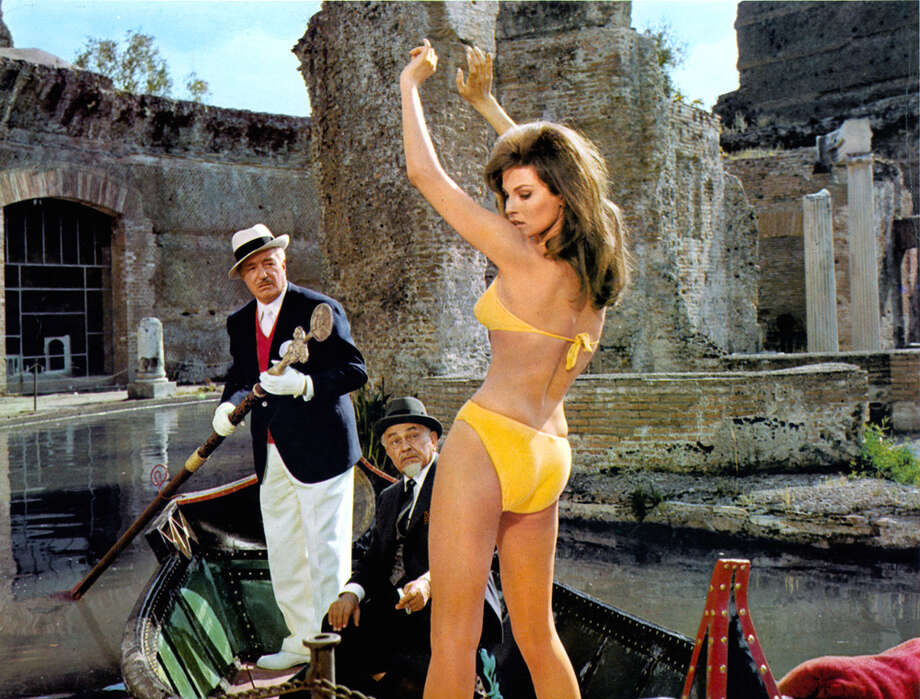 Raquel Welch stands in a boat in a bikini in a scene from the film 'The Biggest Bundle Of Them All', 1968. Photo: Archive Photos, Getty Images / 2012 Getty Images