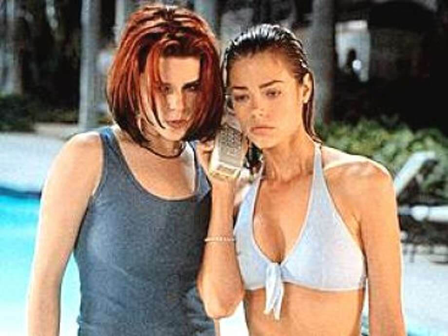 Neve Campbell, left, and Denise Richards were malevolent and disturbed and always around a pool in the 1998 movie ''Wild Things.''