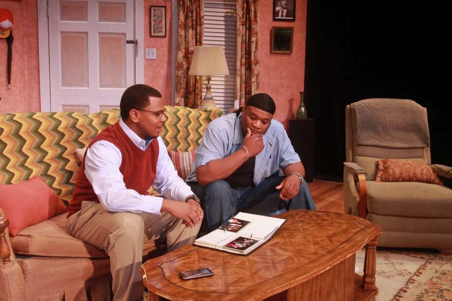 "(For the Chronicle/Gary Fountain, March 15, 2013) Joseph Palmore as Malcolm King, left, and L.D. Green as Ennis King, in this scene from Ensemble Theatre's production of ""Broke-ology."" Photo: Gary Fountain, Freelance / Copyright 2013 Gary Fountain."