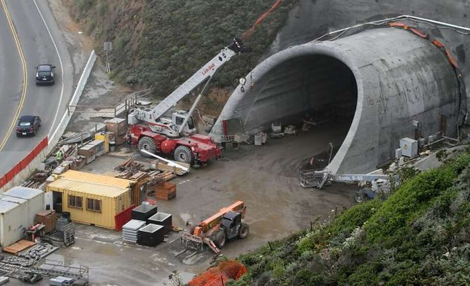 The south portal of the tunnel, which opens next week, was partly completed in this 2011 picture. Construction took about two years longer than projected.