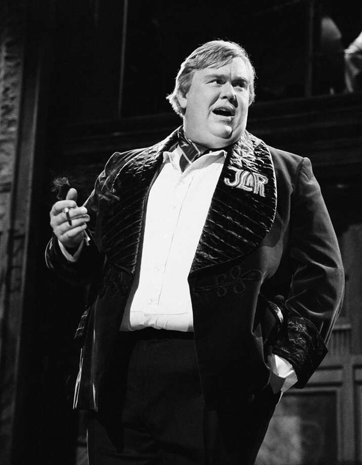 John Candy starred in one of the best known road movies, PLANES TRAINS AND AUTOMOBILES. Photo: NBC / 2012 NBCUniversal Media, LLC