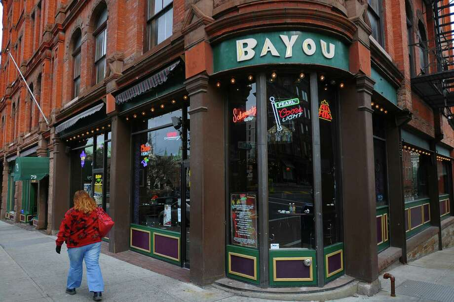 A pedestrian walks past the Bayou Cafe on North Pearl Street in Albany, NY  on Monday  December 6, 2010. The bar was the scene of a brawl four years ago in which someone who was hurt by a state trooper, claims that the bar and the trooper conspired to destroy video evidence of the incident. ( Philip Kamrass / Times Union ) Photo: Philip Kamrass / 00011319A