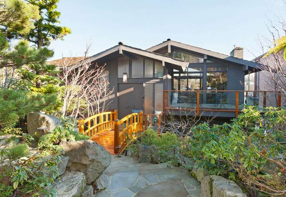 Here's a little sense of Japan in Magnolia, at 5634 39th Ave. W. The 3,220-square-foot modern home, built in 1968, has a Japanese gate and garden, four bedrooms, three bathrooms, a family room, vaulted, exposed wood ceilings, walls of windows, decks and patios, 60 feet of beach frontage and views of boats and ships headed to and from the Ballard locks on a 9,605-square-foot lot. It's listed for $2.4 million. Photo: Courtesy Carol Ard/Windermere Real Estate