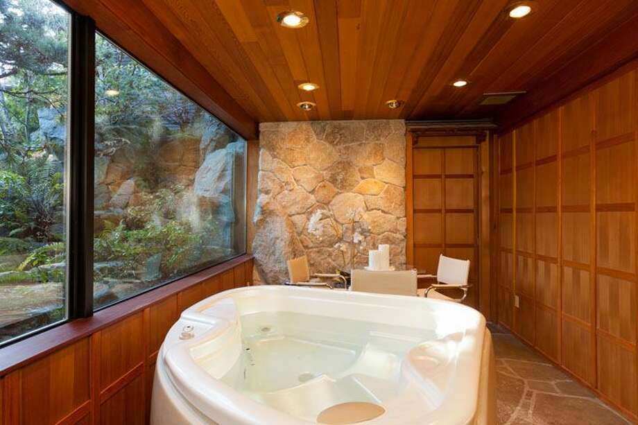 Master bath of 5634 39th Ave. W. The 3,220-square-foot modern home, built in 1968, has a Japanese gate and garden, four bedrooms, three bathrooms, a family room, vaulted, exposed wood ceilings, walls of windows, decks and patios, 60 feet of beach frontage and views of boats and ships headed to and from the Ballard locks on a 9,605-square-foot lot. It's listed for $2.4 million. Photo: Courtesy Carol Ard/Windermere Real Estate