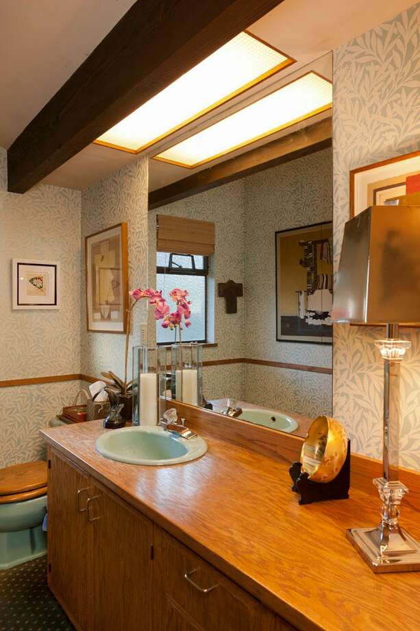 Powder room of 5634 39th Ave. W. The 3,220-square-foot modern home, built in 1968, has a Japanese gate and garden, four bedrooms, three bathrooms, a family room, vaulted, exposed wood ceilings, walls of windows, decks and patios, 60 feet of beach frontage and views of boats and ships headed to and from the Ballard locks on a 9,605-square-foot lot. It's listed for $2.4 million. Photo: Courtesy Carol Ard/Windermere Real Estate