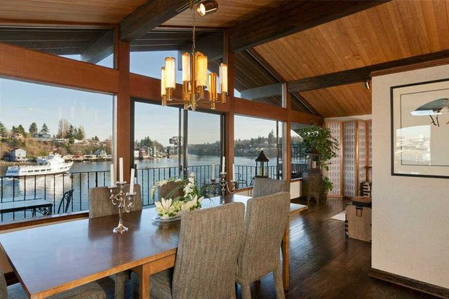 Dining room of 5634 39th Ave. W. The 3,220-square-foot modern home, built in 1968, has a Japanese gate and garden, four bedrooms, three bathrooms, a family room, vaulted, exposed wood ceilings, walls of windows, decks and patios, 60 feet of beach frontage and views of boats and ships headed to and from the Ballard locks on a 9,605-square-foot lot. It's listed for $2.4 million. Photo: Courtesy Carol Ard/Windermere Real Estate