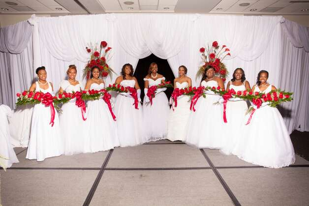 The 2012 Pals Social Club debutante coterie, from left: Grace Seward, Sterling Crisp, Nia Crisp, Chanel Booker, Tyraneisha Loving, Koiana Madison, Brittany Thomas, Oluwaseun Adeyinka and Nichelle Smaller. Photo: Courtesy Allee Wallace