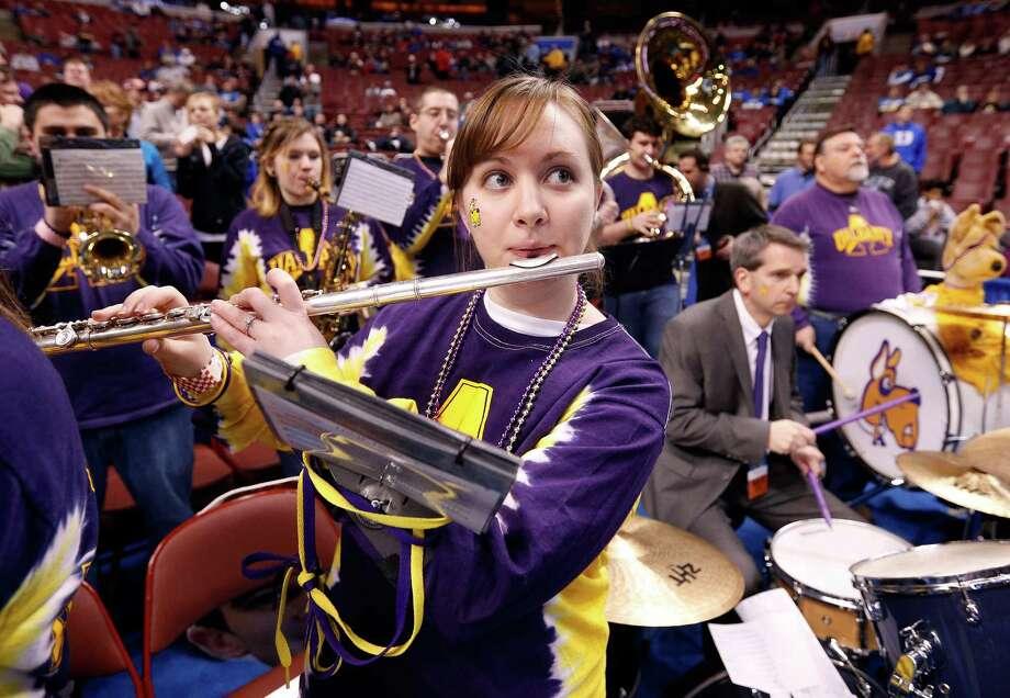 PHILADELPHIA, PA - MARCH 22:  Members of the Albany Great Danes band perform before the Great Danes take on the Duke Blue Devils in the second round of the 2013 NCAA Men's Basketball Tournament on March 22, 2013 at Wells Fargo Center in Philadelphia, Pennsylvania. Photo: Rob Carr, Getty Images / 2013 Getty Images