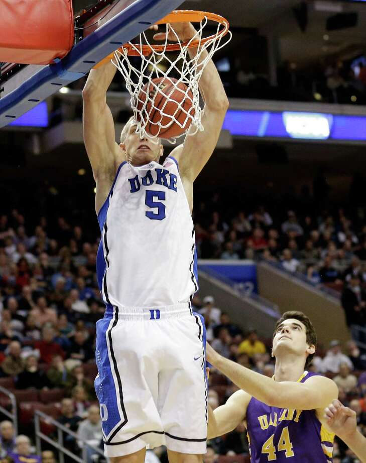 PHILADELPHIA, PA - MARCH 22:  Mason Plumlee #5 of the Duke Blue Devils dunks the ball against John Puk #44 of the Albany Great Danes in the first half during the second round of the 2013 NCAA Men's Basketball Tournament on March 22, 2013 at Wells Fargo Center in Philadelphia, Pennsylvania. Photo: Rob Carr, Getty Images / 2013 Getty Images