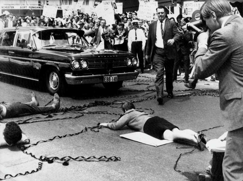 Anti-Vietnam War protestors lie in front of President Lyndon B. Johnson's