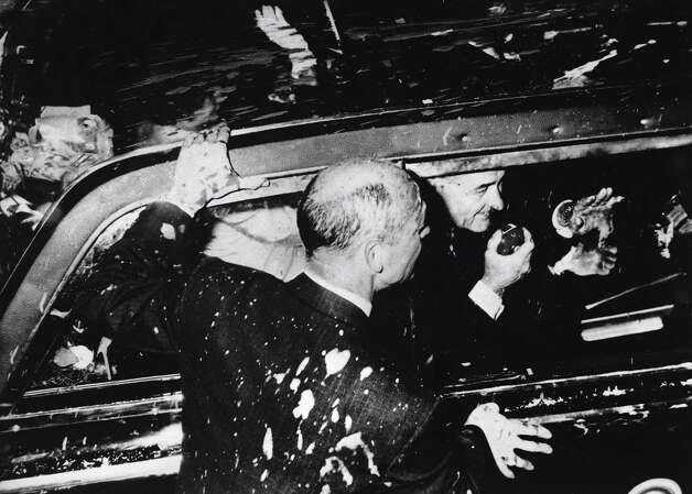 Anti-Vietnam War protestors throw paint at President Lyndon B. Johnson's