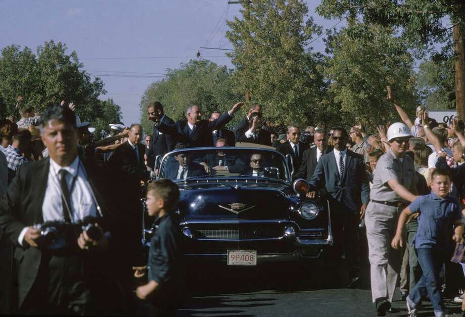 President Lyndon B. Johnson greets crowds from an open-top Cadillac as he campaigns for re-election in September 1964. Photo: Joe Munroe, Getty Images / 2004 Getty Images