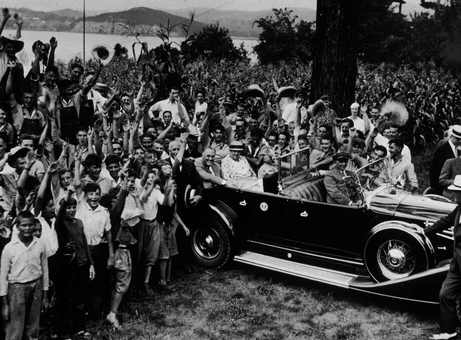 A crowd surrounds President Franklin D. Roosevelt and his mother, Sara D. Roosevelt, as they sit in a convertible during a visit to the Children's Aid Society's 300-acre farm in New Hamburg, N.Y., on Aug. 8, 1933.  The Hudson River is in the background. Photo: New York Times Co., Getty Images / Archive Photos