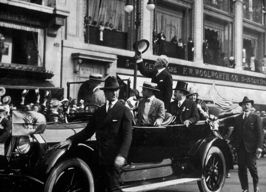 President Woodrow Wilson waves from his car circa 1916. Photo: Museum Of The City Of New York, Getty Images / Archive Photos