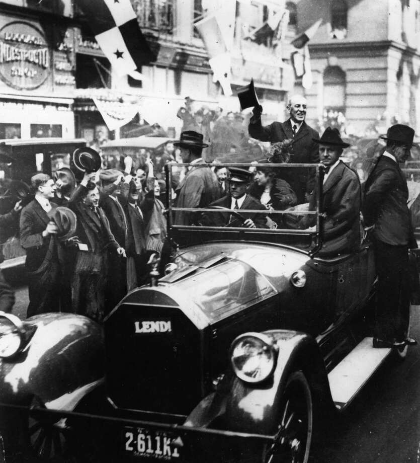 "Crowds of New Yorkers cheer American President Woodrow Wilson  (1856 - 1924) as he drives through the streets on ""Liberty Day,"" Oct. 12, 1918. Photo: Hulton Archive, Getty Images / Hulton Archive"