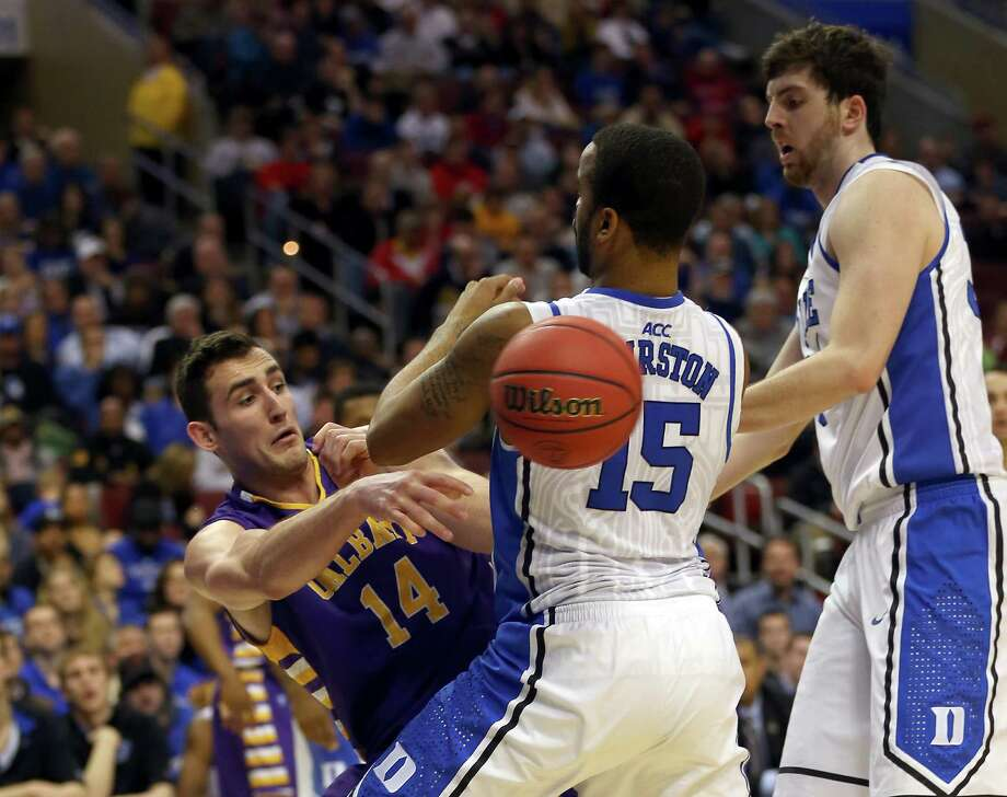 PHILADELPHIA, PA - MARCH 22:  Sam Rowley #14 of the Albany Great Danes passes the ball around Josh Hairston #15 of the Duke Blue Devils in the first half during the second round of the 2013 NCAA Men's Basketball Tournament on March 22, 2013 at Wells Fargo Center in Philadelphia, Pennsylvania. Photo: Elsa, Getty Images / 2013 Getty Images