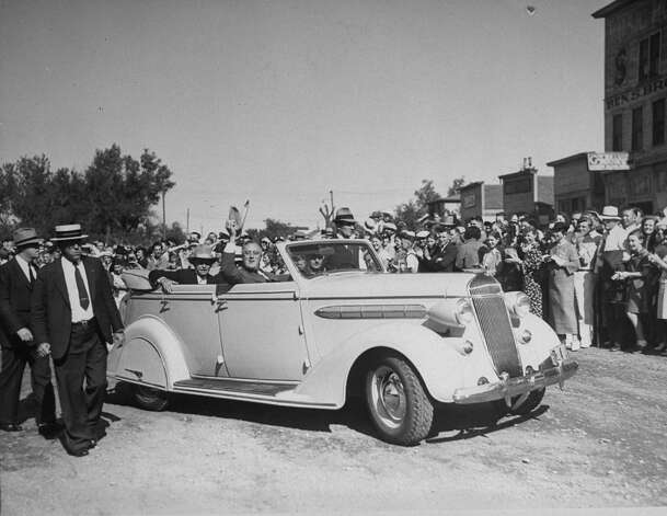 President Franklin D. Roosevelt waves to a crowd in his car during a western trip in 1936. Photo: Thomas D. McAvoy, Time & Life Pictures/Getty Image / Time Life Pictures