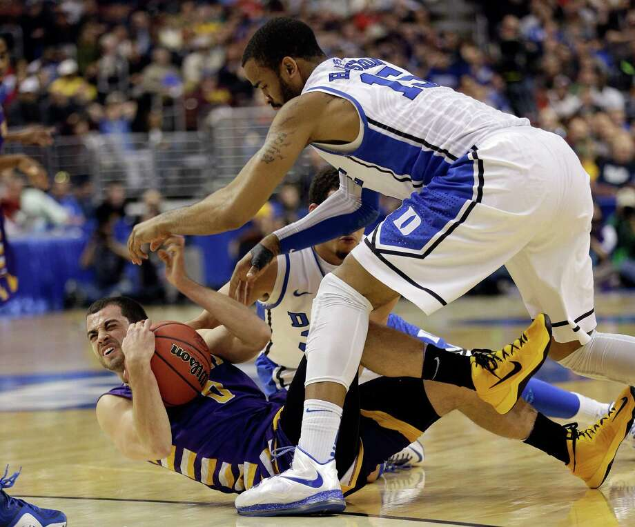 PHILADELPHIA, PA - MARCH 22:  Jacob Iati #0 of the Albany Great Danes with the ball on the floor against Josh Hairston #15 of the Duke Blue Devils in the first half during the second round of the 2013 NCAA Men's Basketball Tournament on March 22, 2013 at Wells Fargo Center in Philadelphia, Pennsylvania. Photo: Rob Carr, Getty Images / 2013 Getty Images