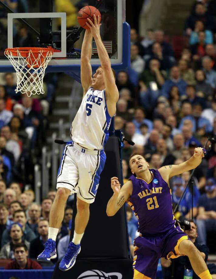 PHILADELPHIA, PA - MARCH 22:  Mason Plumlee #5 of the Duke Blue Devils dunks over Blake Metcalf #21 of the Albany Great Danes in the first half during the second round of the 2013 NCAA Men's Basketball Tournament on March 22, 2013 at Wells Fargo Center in Philadelphia, Pennsylvania. Photo: Elsa, Getty Images / 2013 Getty Images