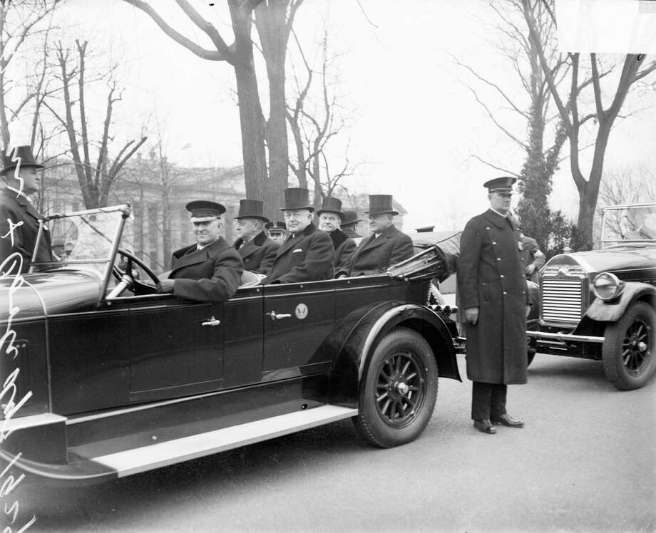 Herbert Hoover, outgoing President Calvin Coolidge and two unidentified men sit in the back seats of a convertible during Hoover's inaugural festivities on March 4, 1929. Photo: Chicago History Museum, Getty Images / Archive Photos