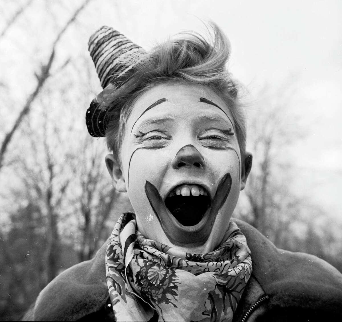Circa 1955: Young clown Ronnie Walken, later film star Christopher Walken, pulls a face for the camera.