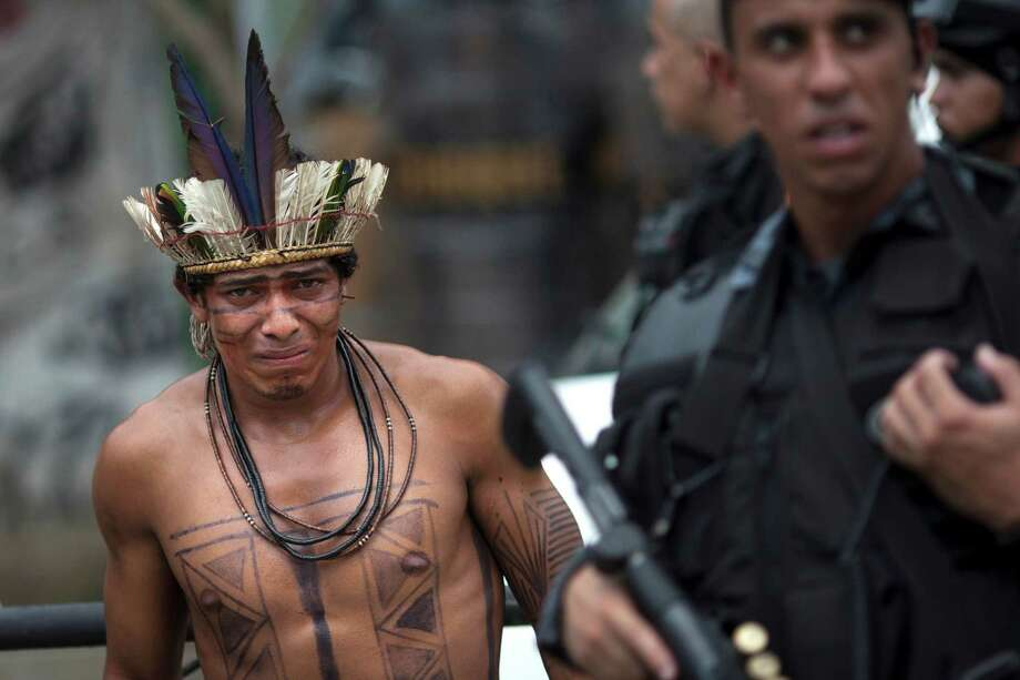 An Indian man cries as he is taken by police from the old Indian Museum during an eviction in Rio de Janeiro, Friday, March 22, 2013. Photo: Felipe Dana, Associated Press / AP