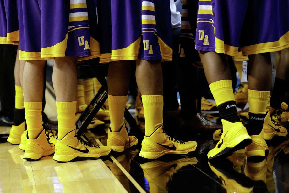 PHILADELPHIA, PA - MARCH 22:  Detail of the shoes and socks of the Albany Great Danes in the first half while taking on the Duke Blue Devils during the second round of the 2013 NCAA Men's Basketball Tournament on March 22, 2013 at Wells Fargo Center in Philadelphia, Pennsylvania. Photo: Rob Carr, Getty Images / 2013 Getty Images