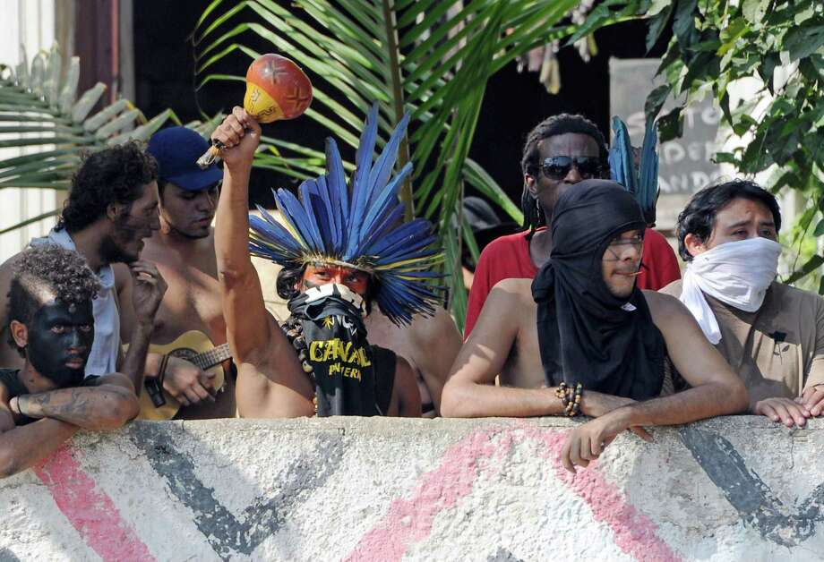 Brazilian natives protest against their eviction by the police from the former Indigenous Museum, next to the Maracana stadium, in Rio de Janeiro, Brazil on March 21, 2013. Indigenous people have been occupying the place since 2006, which is due to be pulled down to construct a parking lot for the upcoming Brazil 2014 FIFA World Cup. Photo: VANDERLEI ALMEIDA, AFP/Getty Images / AFP